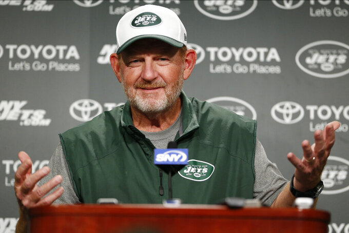 "FILE - In this Nov. 5, 2015, file photo, then-New York Jets offensive coordinator Chan Gailey speaks to reporters during NFL football practice in Florham Park, N.J. Enjoying a life filled with golf and grandkids, Gailey was three years into a pretty typical retirement when it took a twist. Miami Dolphins coach Brian Flores called and offered Gailey a job as offensive coordinator. ""I was taken aback a little bit,"" Gailey said Saturday, Aug. 8, 2020, looking back on that transformative phone conversation seven months ago. (AP Photo/Julio Cortez, File)"