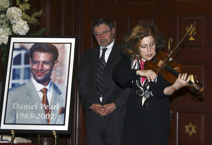FILE - In this April 15, 2007,  file photo, Dr. Judea Pearl, father of American journalist Daniel Pearl, who was killed by terrorists in Pakistan in 2002, listens to violinist Ida Haendel in Miami Beach, Fla. Emma Kostyun, a recent graduate of Pittsfield, Mass. High School, whose love of music developed into a love of the written word and a passion for journalism, was named Wednesday, June 16, 2021, the 2021 recipient of a college scholarship founded in honor of slain Wall Street Journal reporter Daniel Pearl. (AP Photo/Wilfredo Lee, File)