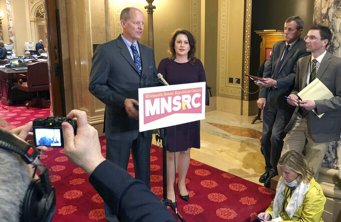 """In this May 2, 2019 photo, Minnesota Senate Majority Leader Paul Gazelka, left, stands next Deputy Majority Leader Michelle Benson as he speaks to reporters at the state Capitol in St. Paul. Benson has launched her campaign for Minnesota governor, saying she'll fight efforts to close schools and businesses or defund the police. She calls herself """"an unwavering conservative fighter"""" in a statement posted on her campaign website. She also posted a YouTube video declaring her candidacy and plans a formal announcement at a machining company in Blaine on Wednesday, Sept. 1, 2021. Meanwhile, GOP Sen. Paul Gazelka, of East Gull Lake, is stepping down as Senate majority leader. (AP Photo/Steve Karnowski, file)"""