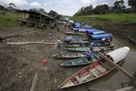 Boats wait for clients on a small canal next to the Amazon River, in Leticia, Colombia, border with Peru and Brazil, Thursday, Sept. 5, 2019. Colombia's President Ivan Duque, Peru's President Martin Vizcarra, and Ecuador's President Lenin Moreno, will meet in Leticia, on their shared Amazon border, in a summit to announce joint measures that these countries will take to protect the Amazon. (AP Photo/Fernando Vergara)