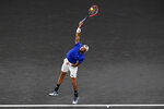 Team Europe's Matteo Berrettini, of Italy, serves to Team World's Felix Auger-Aliassime, of Canada, at Laver Cup tennis, Friday, Sept. 24, 2021, in Boston. (AP Photo/Elise Amendola)