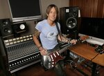 FILE - In this April 14, 2016, photo, Keith Urban poses in Nashville, Tenn. Urban's latest album