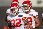 Kansas City Chiefs safety Tyrann Mathieu (32) and teammates run during an NFL football training camp Friday, Aug. 14, 2020, in Kansas City, Mo. (AP Photo/Charlie Riedel)