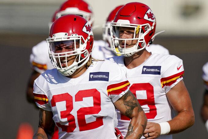 Kansas City Chiefs safety Tyrann Mathieu (32) and teammates run during an NFL football training camp Friday, Aug. 14, 2020, in Kansas City, Mo. (AP Photo/Charlie Riedel)