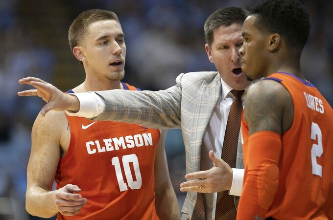 Clemson coach Brad Brownell has a word with Al-Amir Dawes (2) in the first half of an NCAA college basketball game against North Carolina  on Saturday, Jan. 11, 2020, at the Smith Center in Chapel Hill, N.C. (Robert Willett/The News & Observer via AP)