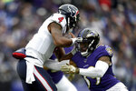 Houston Texans quarterback Deshaun Watson, left, runs with the ball as Baltimore Ravens cornerback Brandon Carr makes the tackle during the first half of an NFL football game, Sunday, Nov. 17, 2019, in Baltimore. (AP Photo/Gail Burton)