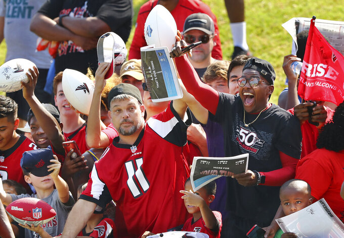 Atlanta Falcons fans seek autographs during an NFL football team practice in Flowery Branch, Ga., Monday, July 29, 2019. (Curtis Compton/Atlanta Journal-Constitution via AP)