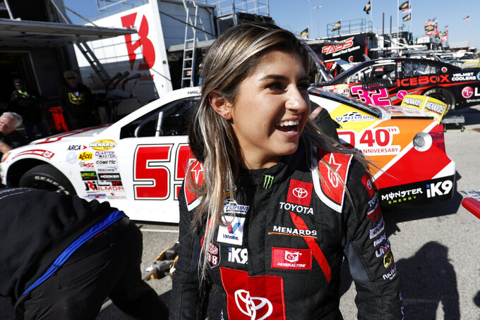 FILE - In this Oct. 18, 2019, file photo, driver Hailie Deegan greets fans after practicing for an ARCA Series auto race at Kansas Speedway in Kansas City, Kan. Deegan has moved from Toyota to Ford in a driver development deal announced Tuesday, Dec. 17, 2019. Ford will work to fast-track the rising star into one of NASCAR's national series over the next few seasons. (AP Photo/Colin E. Braley, File)