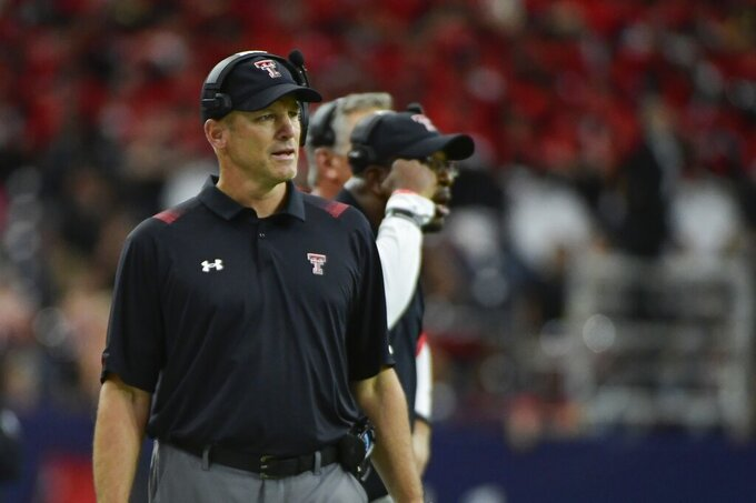 Texas Tech head coach Matt Wells watches from the sidelines as his team plays Houston during the first half of an NCAA college football game Saturday, Sept. 4, 2021, in Houston. (AP Photo/Justin Rex)