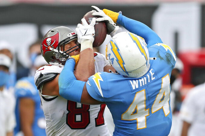 Tampa Bay Buccaneers tight end Rob Gronkowski (87) battles with Los Angeles Chargers outside linebacker Kyzir White (44) for a reception during the second half of an NFL football game Sunday, Oct. 4, 2020, in Tampa, Fla. Gronkowski came away with the catch. (AP Photo/Mark LoMoglio)