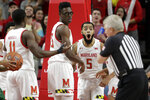 Maryland guard Eric Ayala (5) reacts as referee Eric Curry, right, calls him for a technical foul after a dunk against George Mason during the first half of an NCAA college basketball game Friday, Nov. 22, 2019, in College Park, Md. (AP Photo/Julio Cortez)