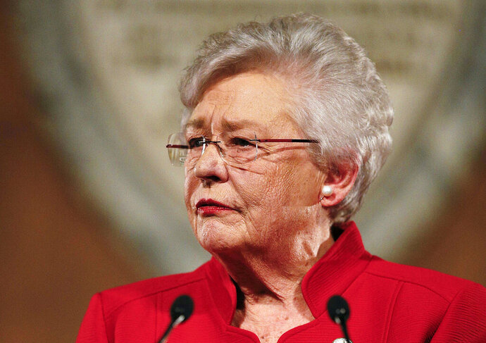 FILE- In this Jan. 9, 2018, file photo, Alabama Gov. Kay Ivey delivers the annual State of the State address at the Capitol in Montgomery, Ala. Ivey signed the nation's strictest abortion ban into law on Wednesday, May 15, 2019, making performing an abortion a felony in nearly all cases, punishable by up to life in prison, and with no exceptions for rape and incest.  (AP Photo/Brynn Anderson, File)