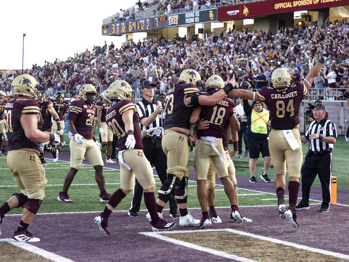 Texas State receiver Marcell Barbee (18) celebrates his touchdown catch with teammates during the first half of an NCAA college football game against Baylor, Saturday, Sept. 4, 2021, in San Marcos, Texas. (AP Photo/Michael Thomas)