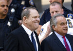 Harvey Weinstein, left, with his attorney Benjamin Brafman, right, leaves a Manhattan courthouse, Monday, July 9, 2018, in New York. Weinstein, who was previously indicted on charges involving two women, was released on bail on Monday while fighting sex crime accusations that now include a third woman. (AP Photo/Craig Ruttle)