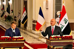 French President Emmanuel Macron, left, and Iraq's President Barham Salihat, right, give a news conference at the presidential palace, in Baghdad, Iraq, Wednesday, Sept. 2, 2020. Macron is the first head of state to visit the Iraqi capital since the country's new prime minister and Iraq's former intelligence chief formed a government in May. (AP Photo/Khalid Mohammed)