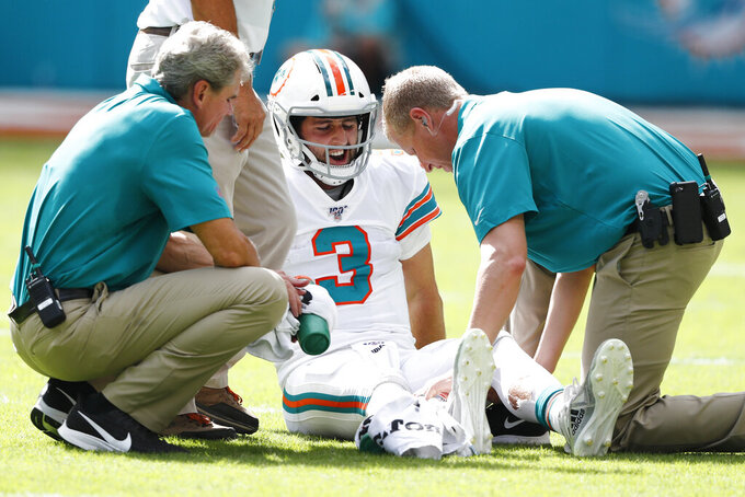 Miami Dolphins quarterback Josh Rosen (3) is attended on the field, during the second half at an NFL football game against the New England Patriots, Sunday, Sept. 15, 2019, in Miami Gardens, Fla. (AP Photo/Brynn Anderson)