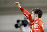 Ferrari driver Charles Leclerc of Monaco celebrates his pole position after the qualifying session at the Formula One Bahrain International Circuit in Sakhir, Bahrain, Saturday, March 30, 2019. The Bahrain Formula One Grand Prix will take place on Sunday. (AP Photo/Luca Bruno)