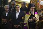 Ecumenical Patriarch Bartholomew I, right, and Greece's Prime Minister Alexis Tsipras, center, attend a church service during their visit at the Theological School of Halki, in Heybeli Island, near Istanbul, Wednesday, Feb. 6, 2019. The president of Turkey and the prime minister of Greece agreed Tuesday on the need to keep