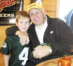 FILE - In this Dec. 10, 2006 file photo, former Green Bay Packers great Fuzzy Thurston poses with Kristopher Hassamer of Cadott, at a book signing at Latigo and Lace bar in Cadott, Wis. Herb Adderley, who turns 80 next month, won five championships in Green Bay, including the first two Super Bowls, plus another with Tom Landry's Dallas Cowboys in 1971, as did Forrest Gregg, who died last month at age 85. Their Green Bay teammate, Thurston, who died in 2014, won all six of his titles with Lombardi and the Packers just as Brady has won each of his half dozen rings in New England with coach Bill Belichick. (Mark Gunderman/The Chippewa Herald-Telegram via AP, File)
