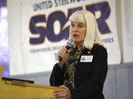 """In this Sept. 21, 2018, photo, U.S. Congress candidate Diane Mitsch Bush speaks at the United Steelworkers of America Local #2102, in Pueblo, Colo. Lauren Boebert, who owns an open-carry, """"family friendly"""" restaurant, pulled off the upset of the summer by defeating a five-term incumbent in the Republican primary for Colorado's 3rd Congressional District. Boebert's Democratic opponent is Mitsch Bush, a retired sociology professor, former state lawmaker and county commissioner from the trendy ski town of Steamboat Springs who is making her second run for the seat. (Andy Cross/The Denver Post via AP)"""