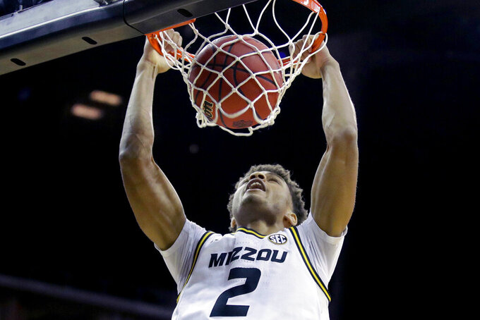 Missouri forward Tray Jackson dunks during the first half of an NCAA college basketball game against Butler, Monday, Nov. 25, 2019, in Kansas City, Mo. (AP Photo/Charlie Riedel)