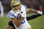 UCLA's Kyle Philips runs for a touchdown during the first half of the team's NCAA college football game against Stanford on Thursday, Oct. 17, 2019, in Stanford, Calif. (AP Photo/Ben Margot)