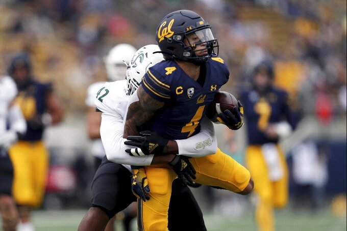 California wide receiver Nikko Remigio (4) runs after a catch against Sacramento State defensive lineman Marshaun Hunter (42) during the first half of an NCAA college football game on Saturday, Sept. 18, 2021, in Berkeley, Calif. (AP Photo/Jed Jacobsohn)