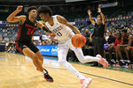 Washington forward Jayden McDaniels (0) tries to get past Houston guard Quentin Grimes (24) during the first half of an NCAA college basketball game Wednesday, Dec. 25, 2019, in Honolulu. (AP Photo/Marco Garcia)
