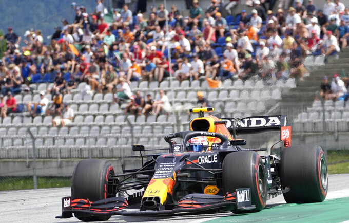 Red Bull driver Sergio Perez of Mexico steers his car during the Styrian Formula One Grand Prix at the Red Bull Ring racetrack in Spielberg, Austria, Sunday, June 27, 2021. (AP Photo/Darko Vojinovic)