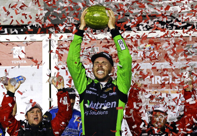 Ross Chastain celebrates in Victory Lane after winning the NASCAR Xfinity Series auto race at Daytona International Speedway, Saturday, July 6, 2019, in Daytona Beach, Fla. (AP Photo/Terry Renna)