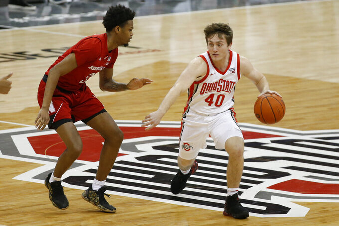 Ohio State's Jansen Davidson, right, is defended by Nebraska's Elijah Wood during the second half of an NCAA college basketball game Wednesday, Dec. 30, 2020, in Columbus, Ohio. (AP Photo/Jay LaPrete)