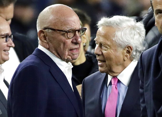 Media Mogul Rupert Murdoch, left, stands with New England Patriots owner Robert Kraft to watch the teams warm up before an NFL football game between the Patriots and the New York Giants, Thursday, Oct. 10, 2019, in Foxborough, Mass. (AP Photo/Elise Amendola)