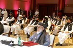 Taliban negotiator Abbas Stanikzai, right, with his delegation attends the opening session of the peace talks between the Afghan government and the Taliban in Doha, Qatar, Saturday, Sept. 12, 2020. (AP Photo/Hussein Sayed)