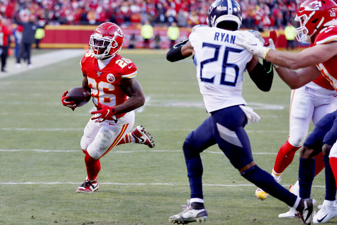 Kansas City Chiefs' Damien Williams runs for a touchdown past Tennessee Titans cornerback Logan Ryan (26) during the second half of the NFL AFC Championship football game Sunday, Jan. 19, 2020, in Kansas City, MO. (AP Photo/Charlie Neibergall)