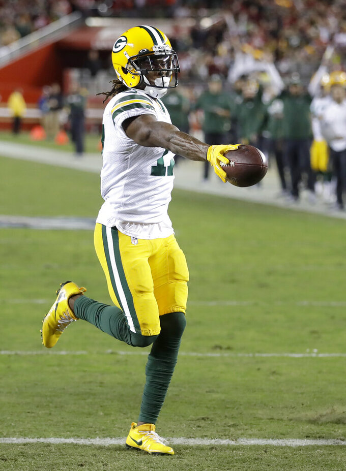 Green Bay Packers wide receiver Davante Adams scores against the San Francisco 49ers during the second half of an NFL football game in Santa Clara, Calif., Sunday, Nov. 24, 2019. (AP Photo/Ben Margot)