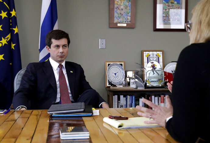 Mayor Pete Buttigieg listens to an AP reporter at his office in South Bend, Ind., Thursday, Jan. 10, 2019.  Few people know Pete Buttigieg's name outside the Indiana town where he's mayor, but none of that has deterred him from contemplating a 2020 Democratic presidential bid. He's among the potential candidates who believe 2016 and 2018 showed voters are looking for fresh faces.  (AP Photo/Nam Y. Huh)