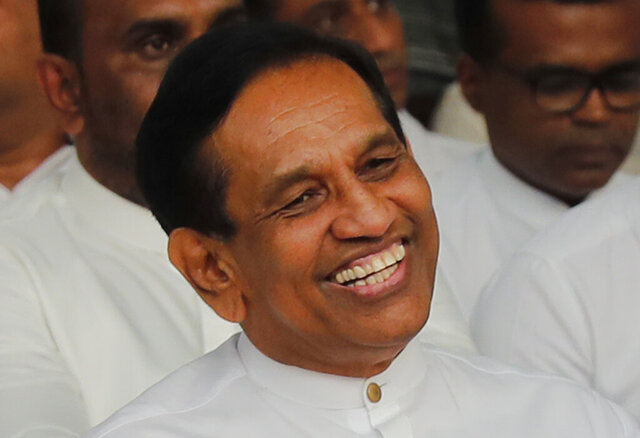 In this Monday, Dec. 23, 2019, photo, former Cabinet minister Rajitha Senaratne participates in a protest in Colombo, Sri Lanka. Sri Lankan police arrested the hospitalized former Cabinet minister on Friday, Dec. 27, for alleged involvement in organizing a news conference about abductions under the government of the current president's brother. Lawyer Gunaratna Wanninayake said Senarathna, now an opposition lawmaker, was arrested at a private hospital where he was admitted on Thursday. (AP Photo/Eranga Jayawardena)