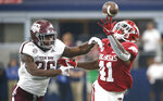 Texas A&M defensive back Demani Richardson (26) defends as Arkansas running back T.J. Hammonds (41) fails to make a catch during the second half of an NCAA college football game Saturday, Sept. 28, 2019, in Arlington, Texas. Texas A&M won 31-27. (AP Photo/Ron Jenkins)