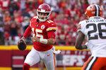 Kansas City Chiefs quarterback Patrick Mahomes (15) scrambles as Cleveland Browns cornerback Greedy Williams (26) defends during the second half of an NFL football game Sunday, Sept. 12, 2021, in Kansas City, Mo. (AP Photo/Ed Zurga)