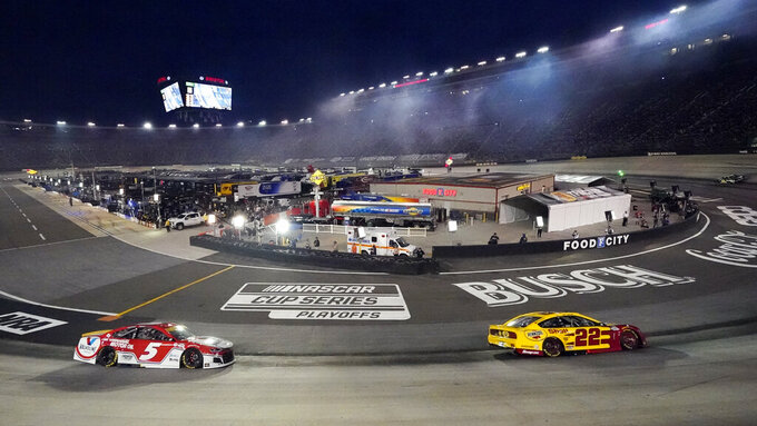 Drives come through a turn during a NASCAR Cup Series auto race at Bristol Motor Speedway Saturday, Sept. 18, 2021, in Bristol, Tenn. (AP Photo/Mark Humphrey)