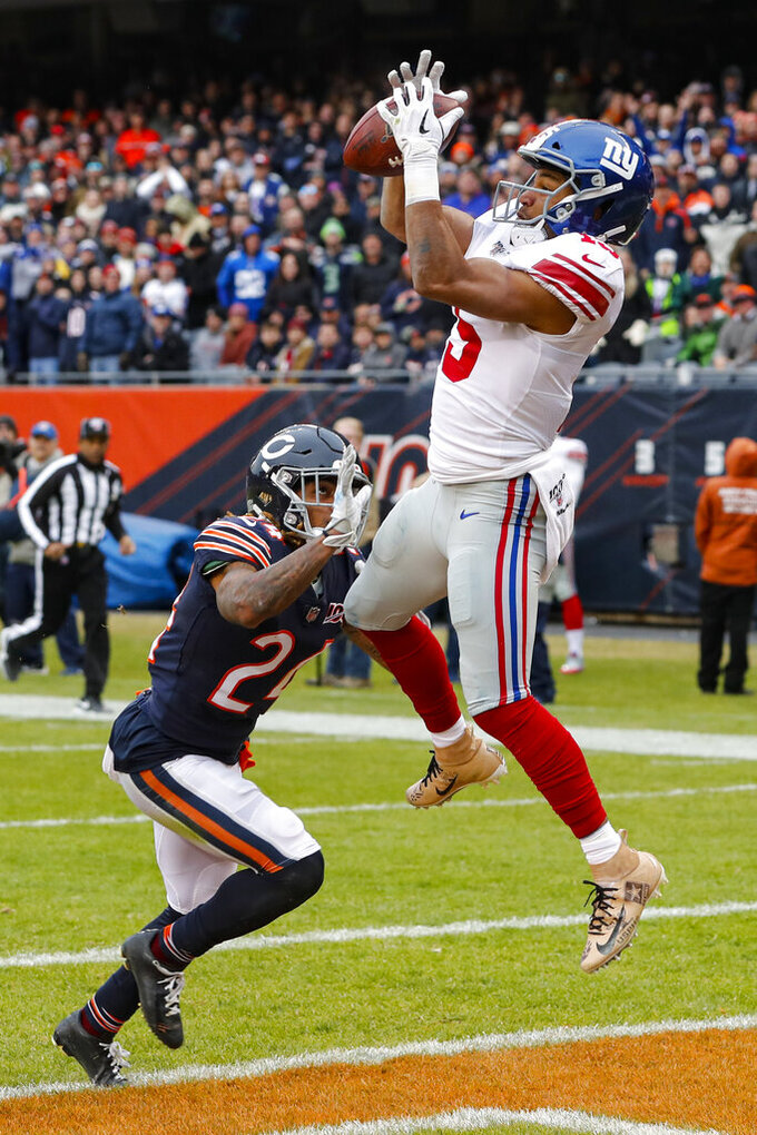 New York Giants wide receiver Golden Tate (15) makes a catch for a touchdown over Chicago Bears cornerback Buster Skrine (24) during the second half of an NFL football game in Chicago, Sunday, Nov. 24, 2019. (AP Photo/Charles Rex Arbogast)