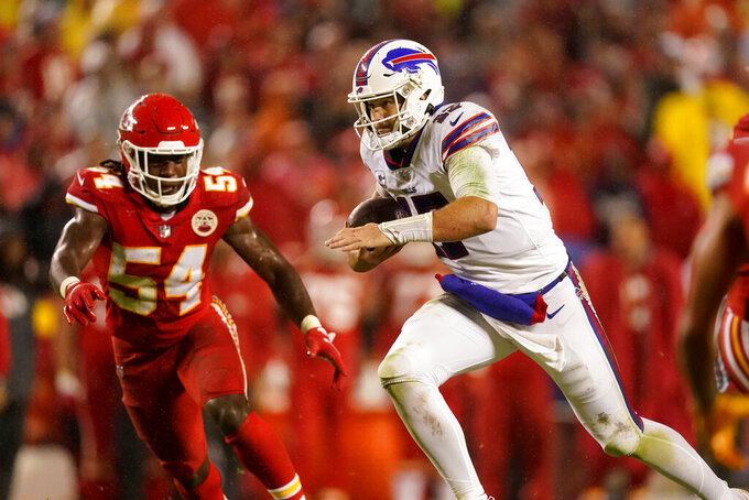 Buffalo Bills quarterback Josh Allen, right, runs with the ball as Kansas City Chiefs linebacker Nick Bolton (54) defends during the second half of an NFL football game Sunday, Oct. 10, 2021, in Kansas City, Mo. (AP Photo/Charlie Riedel)