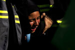 """A Lebanese Shiite supporter of Hezbollah cries as she listens to the story of Imam Hussein, during activities marking the holy day of Ashoura, in southern Beirut, Lebanon, Thursday, Aug. 19, 2021. The leader of the militant Hezbollah group Sayyed Hassan Nasrallah said Thursday that the first Iranian fuel tanker will sail toward Lebanon """"within hours"""" warning Israel and the United States not to intercept it. (AP Photo/ Hassan Ammar)"""