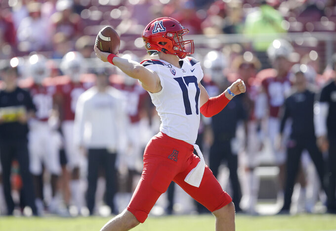 Arizona quarterback Grant Gunnell passes against Stanford in the first half of an NCAA college football game Saturday, Oct. 26, 2019, in Stanford, Calif. (AP Photo/Ben Margot)
