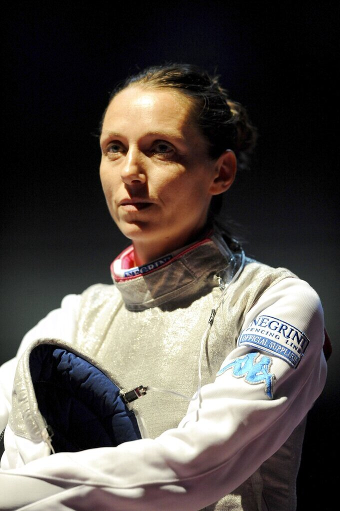 FILE - In this Aug. 7, 2013 file photo, Valentina Vezzali of Italy is seen during in the quarterfinal of the women's individual foil competition of the fencing World Championships in Budapest, Hungary. Six-time Olympic fencing champion Valentina Vezzali was named the Italian government's cabinet undersecretary in charge of sports on Friday. The 47-year-old Vezzali will be in charge of relations with the Italian Olympic Committee (CONI) and also oversee amateur sports across the country. (AP Photo/MTI, Imre Foldi)