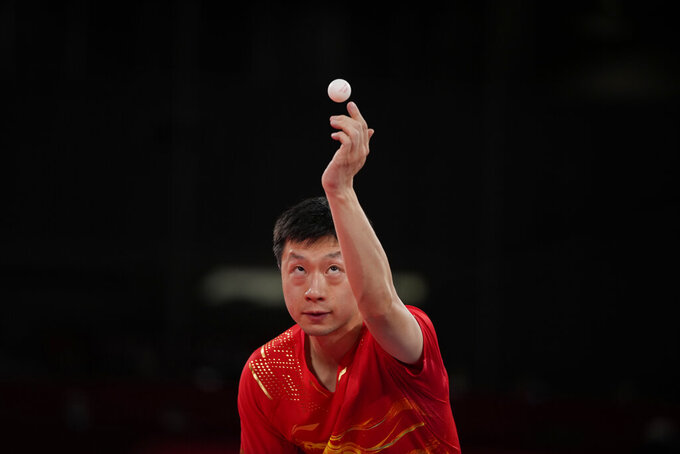 China's Ma Long competes during the table tennis men's singles quarterfinal match against Egypt's Omar Assarat at the 2020 Summer Olympics, Wednesday, July 28, 2021, in Tokyo. (AP Photo/Kin Cheung)