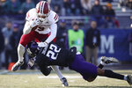 Massachusetts' Isaiah Rodgers, left, is tackled by Northwestern's Bryce Jackson during the second half of an NCAA college football game Saturday, Nov. 16, 2019, in Evanston, Ill. (AP Photo/Jim Young)