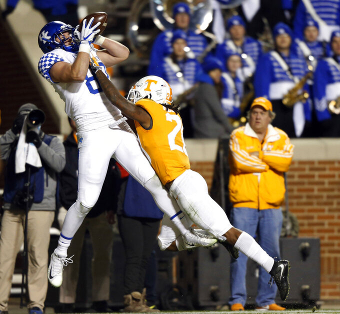 Kentucky tight end C.J. Conrad (87) catches a pass for a touchdown as he's defended by Tennessee defensive back Baylen Buchanan (28) in the second half of an NCAA college football game Saturday, Nov. 10, 2018, in Knoxville, Tenn. Tennessee won 24-7. (AP Photo/Wade Payne)