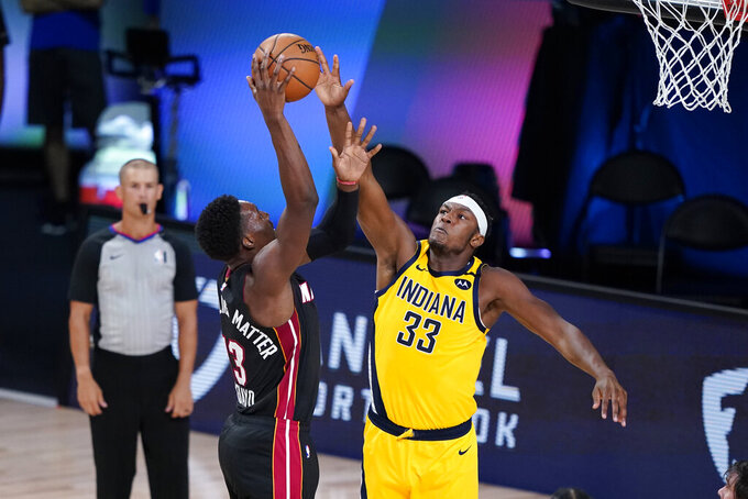 Miami Heat forward Bam Adebayo (13) tries to shoot over Indiana Pacers center Myles Turner (33) during the first half of an NBA basketball first round playoff game, Tuesday, Aug. 18, 2020, in Lake Buena Vista, Fla. (AP Photo/Ashley Landis, Pool)