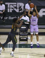 Kansas State guard Nijel Pack (24) shoots a three point shot over Baylor guard Davion Mitchell (45) in the first half of an NCAA college basketball game, Wednesday, Jan. 27, 2021, in Waco, Texas. (AP Photo/Jerry Larson)